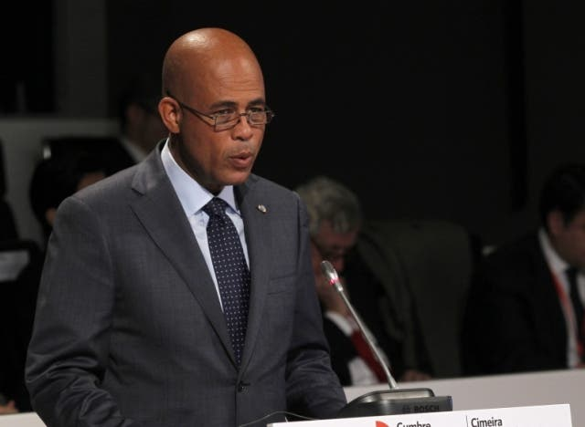 Republic of Haiti's Prime Minister Michel Martelly sepaks during a plenary session as part of the XXII Ibero-American Summit of Head of States and Governments in Cadiz on November 17, 2012.      AFP PHOTO/ POOL/ J.J GUILLEN