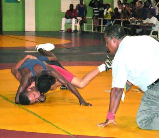 Acción de las actividades del torneo nacional de lucha en COJPD