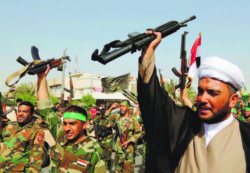 Milicianos chiies exhiben sus armas en ciudades iraquíes