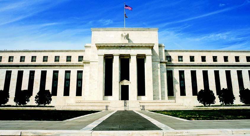 la Reserva Federal redujo las previsiones de crecimiento de la economía estadounidense  para 2014