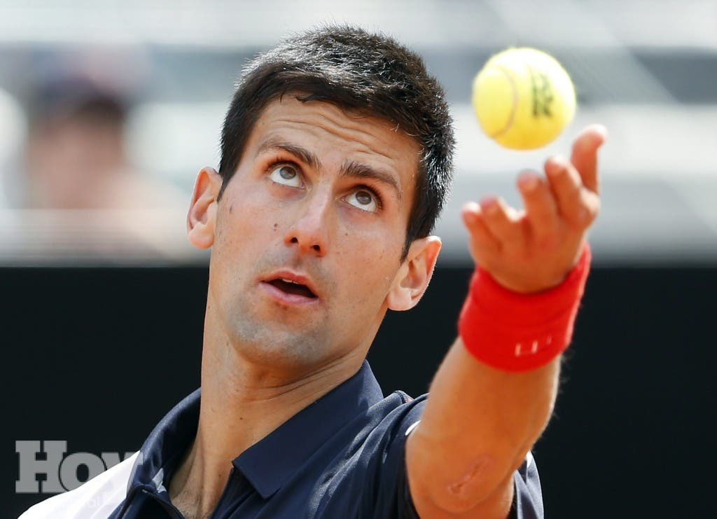 Djokovic of Serbia serves the ball to Raonic of Canada in their men's singles semi-final match at the Rome Masters tennis tournament
