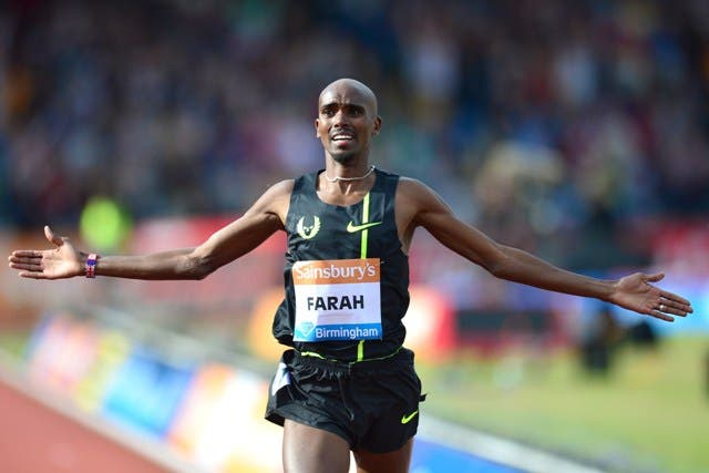 (Files) In this file picture taken on August 24, 2014, Britain's Mo Farah celebrates after winning the men's 2 mile race during the Diamond League Athletics meeting in Birmingham. British track great Mo Farah became the first home runner to win the men's Great North Run race since Steve Kenyon in 1985 as he won a thrilling duel with Kenyan and former training partner Mike Kigen in Newcastle on Sunday, September 7, 2014. AFP PHOTO/CARL COURT