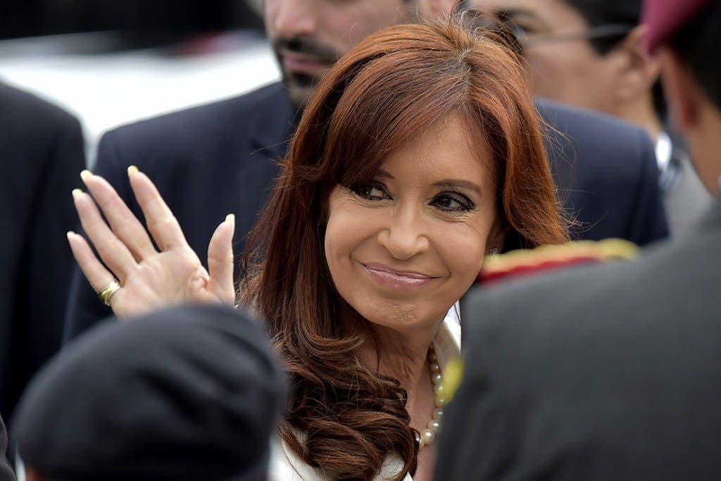 Argentine President Cristina Fernandez de Kirchner waves during the inauguration of the UNASUR headquarters in Quito on December 5, 2014.  AFP PHOTO / RODRIGO BUENDIA