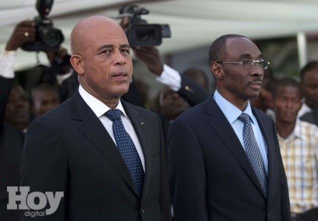 Presidente haitiano  Michel Martelly  y el Primer  Minisro Evans
