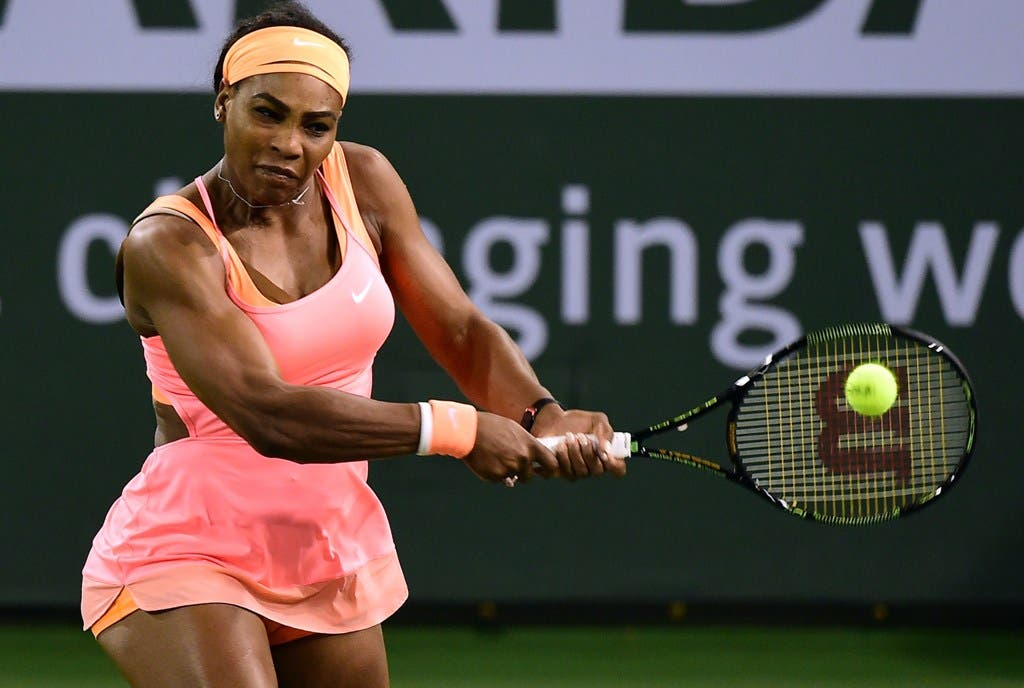 Serena Williams of the US hits a backhand return to Timea Bacsinszky of Switzerland during their quarterfinal match at the BNP Paribas Tennis Open in Indian Wells, California on March 18, 2015.  AFP PHOTO/ FREDERIC J. BROWN