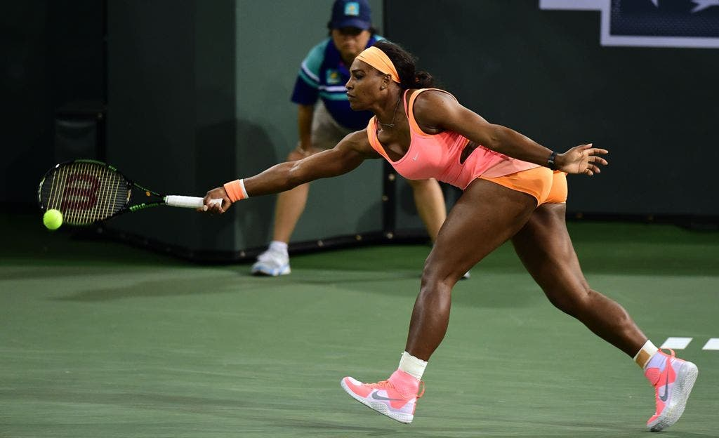 Serena Williams of the US reaches for a forehand return to Timea Bacsinszky of Switzerland during their quarterfinal match at the BNP Paribas Tennis Open in Indian Wells, California on March 18, 2015.  AFP PHOTO/ FREDERIC J. BROWN