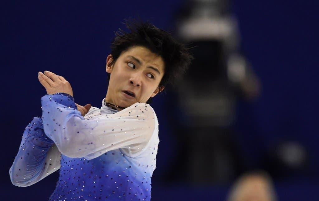 Yuzuru Hanyu of Japan performs during the men's short program of the 2015 ISU World Figure Skating Championships at Shanghai Oriental Sports Center in Shanghai, on March 27, 2015.   AFP PHOTO / JOHANNES EISELE