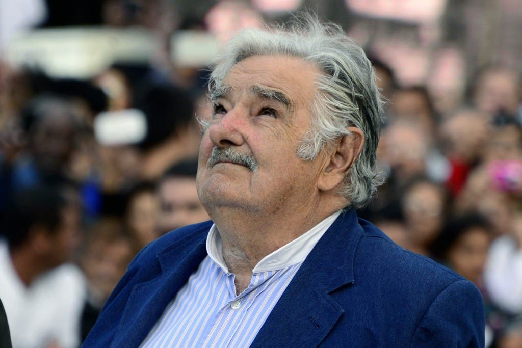 Uruguayan President Jose Mujica looks on during his farewell ceremony in Montevideo on February 27, 2015, two days before the swearing in ceremony of the president-elect Tabare Vazquez.  AFP PHOTO / PABLO PORCIUNCULA