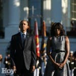 President Barack Obama and first lady Michelle Obama pause on the South Lawn of the White House in Washington, Friday, Sept. 11, 2015, as they observed a moment of silence to mark the 14th anniversary of the 9/11 attacks. (AP/Andrew Harnik)