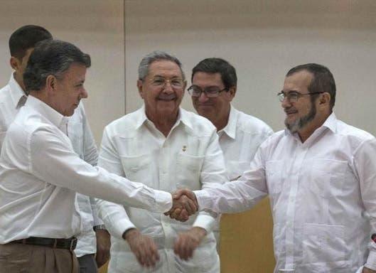 Juan Manuel Santos y Tomochenko