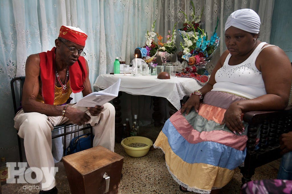 """Santería is a system of beliefs that merge the Yoruba religion with Roman Catholic and Native Indian traditions. This ceremony is called """"Cajon de Muertos"""".  Havana (La Habana), Cuba"""