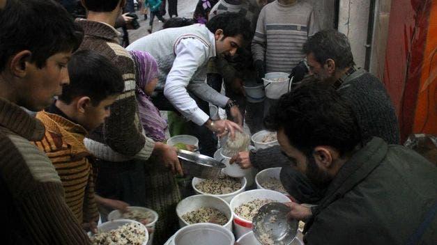 Reparto-comida-ciudad-Alepo_TINIMA20140115_0422_5