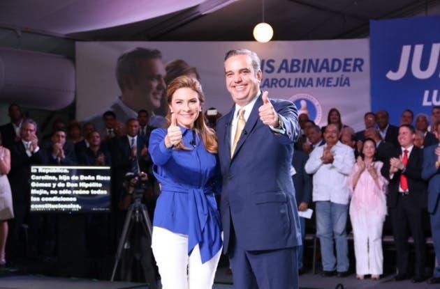 Luis Abinader y Carolina Mejía