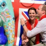 Britain's Prince William (R), Duke of Cambridge, and Catherine (C), Duchess of Cambridge, paint an elephant statue at Kaziranga Discovery Park in Panbari village, in Kaziranga, some 250 km from Guwahati, the capital of the north-eastern state of Assam on April 13, 2016. / AFP / Biju BORO
