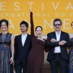 "(FromL) Brazilian actress Barbara Colen, Brazilian actress Maeve Jinkings, Brazilian actor Pedro Queiroz, Brazilian actress Sonia Braga, Brazilian director Kleber Mendonca Filho and French-Brazilian producer Emilie Lesclaux pose as they arrive on May 17, 2016 for the screening of the film ""Aquarius"" at the 69th Cannes Film Festival in Cannes, southern France.  / AFP / Valery HACHE"