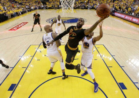 Cleveland Cavaliers forward LeBron James (23) shoots against the Golden State Warriors during the first half of Game 7 of basketball's NBA Finals in Oakland, Calif., Sunday, June 19, 2016. (AP Photo/Marcio Jose Sanchez, Pool)