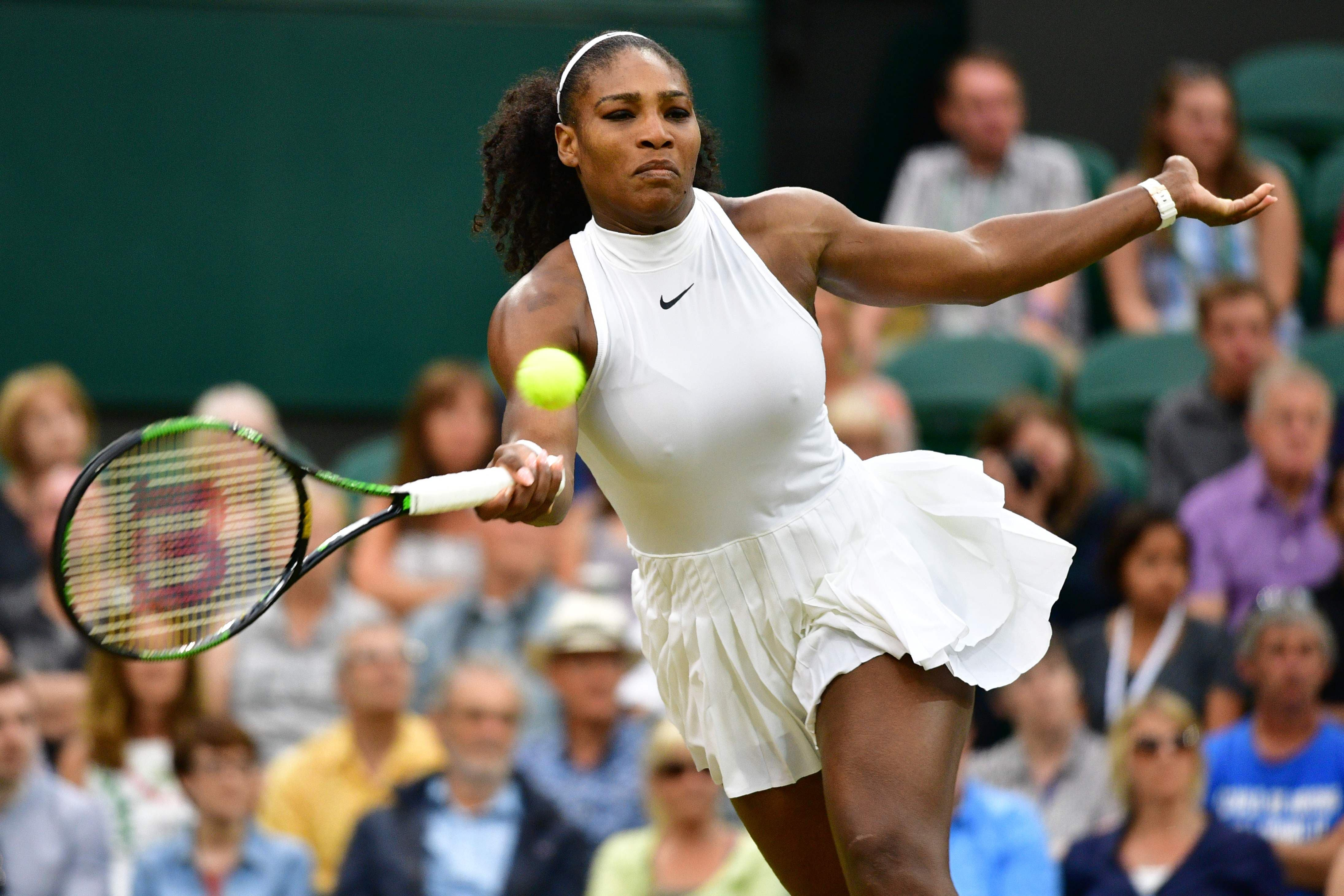 US player Serena Williams returns to Russia's Svetlana Kuznetsova during their women's singles fourth round match on the eighth day of the 2016 Wimbledon Championships at The All England Lawn Tennis Club in Wimbledon, southwest London, on July 4, 2016. RESTRICTED TO EDITORIAL USE  / AFP / LEON NEAL / RESTRICTED TO EDITORIAL USE