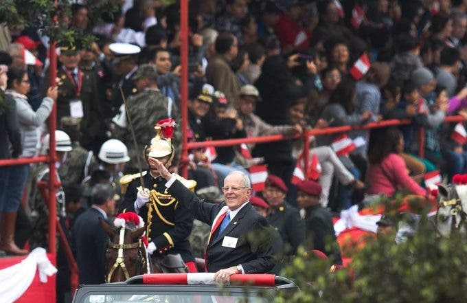 """Peru's President Pedro Pablo Kuczynski waves as he arrives at a military parade marking the country's independence from Spain in Lima, Peru, Friday, July 29, 2016. Kuczynski assumed Peru's presidency Thursday telling Congress in his inaugural speech, """"I want Peru to be a beacon of civilization along the Pacific and in South America that everyone will look upon with admiration."""" (AP Photo/Martin Mejia)"""