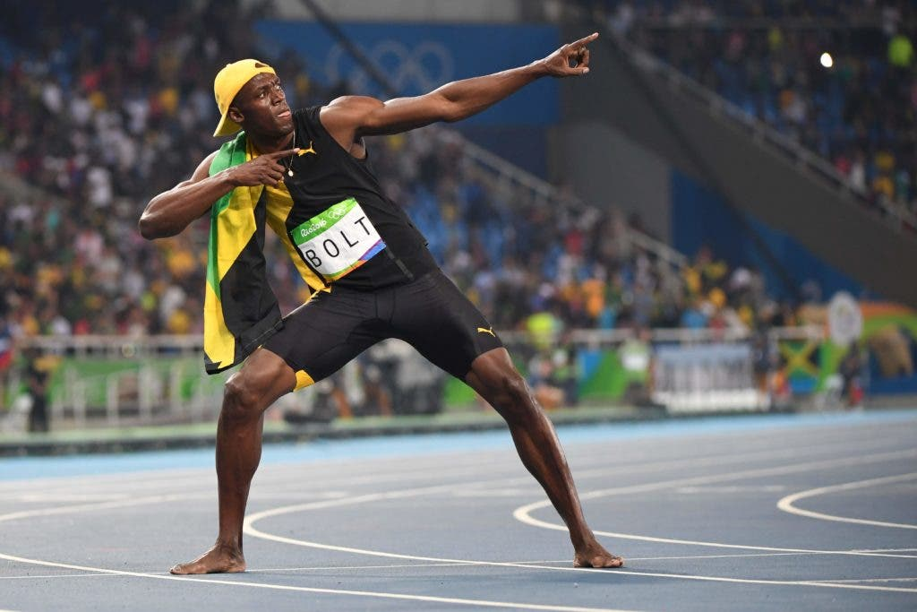 Jamaica's Usain Bolt does his 'Lightening Bolt' pose as he celebrates winning the Men's 100m Final during the athletics event at the Rio 2016 Olympic Games at the Olympic Stadium in Rio de Janeiro on August 14, 2016.   / AFP / OLIVIER MORIN