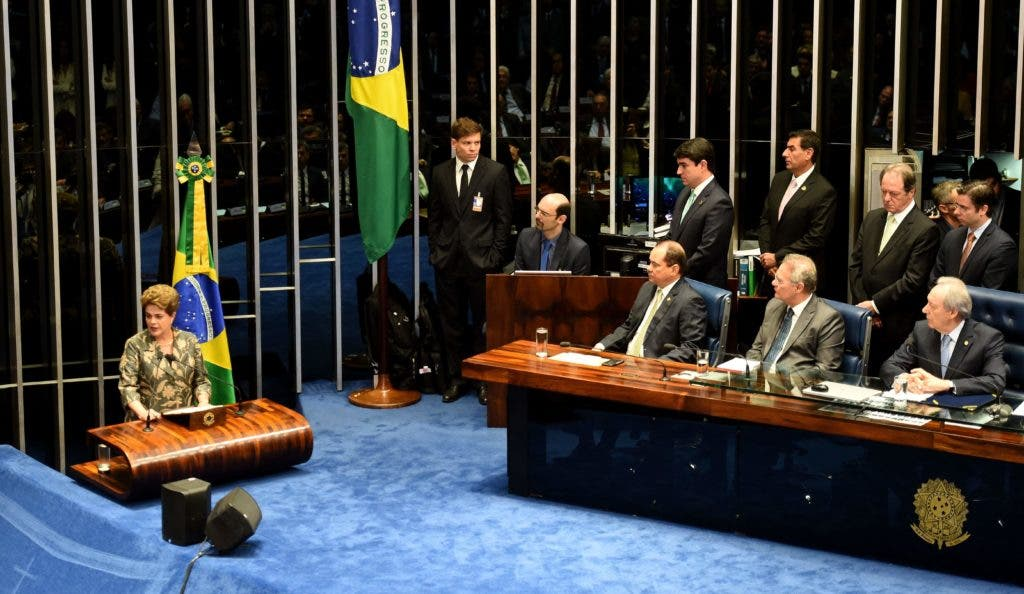 Suspended Brazilian President Dilma Rousseff (L) delivers her speech during the impeachment trial, at the National Congress in Brasilia, on August 29, 2016. Rousseff arrived at the Senate to defend herself confronting her accusers in a dramatic finale to a Senate impeachment trial likely to end 13 years of leftist rule in Latin America's biggest country. / AFP / EVARISTO SA
