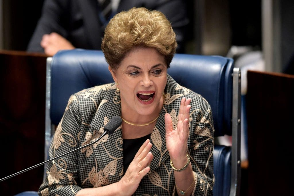 TOPSHOT - Suspended Brazilian President Dilma Rousseff answers to questions during the impeachment trial, at the National Congress in Brasilia, on August 29, 2016. Rousseff who testified for the first time at her trial, urged the Senate to vote against impeaching her, denying charges that she fiddled government accounts.  / AFP / EVARISTO SA