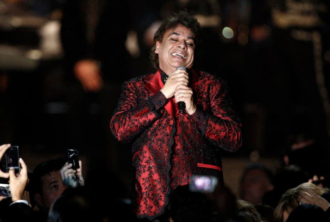 FILE - In this Nov. 4, 2009, file photo, Juan Gabriel performs at the Latin Recording Academy Person of The Year event in his honor in Las Vegas. Representatives of Juan Gabriel have reported Sunday, Aug. 28, 2016, that he has died. Gabriel was Mexico's leading singer-songwriter and top-selling artist with sales of more than 100 million albums. The statement says he died Sunday, but did not say where. (AP Photo/Matt Sayles, File)
