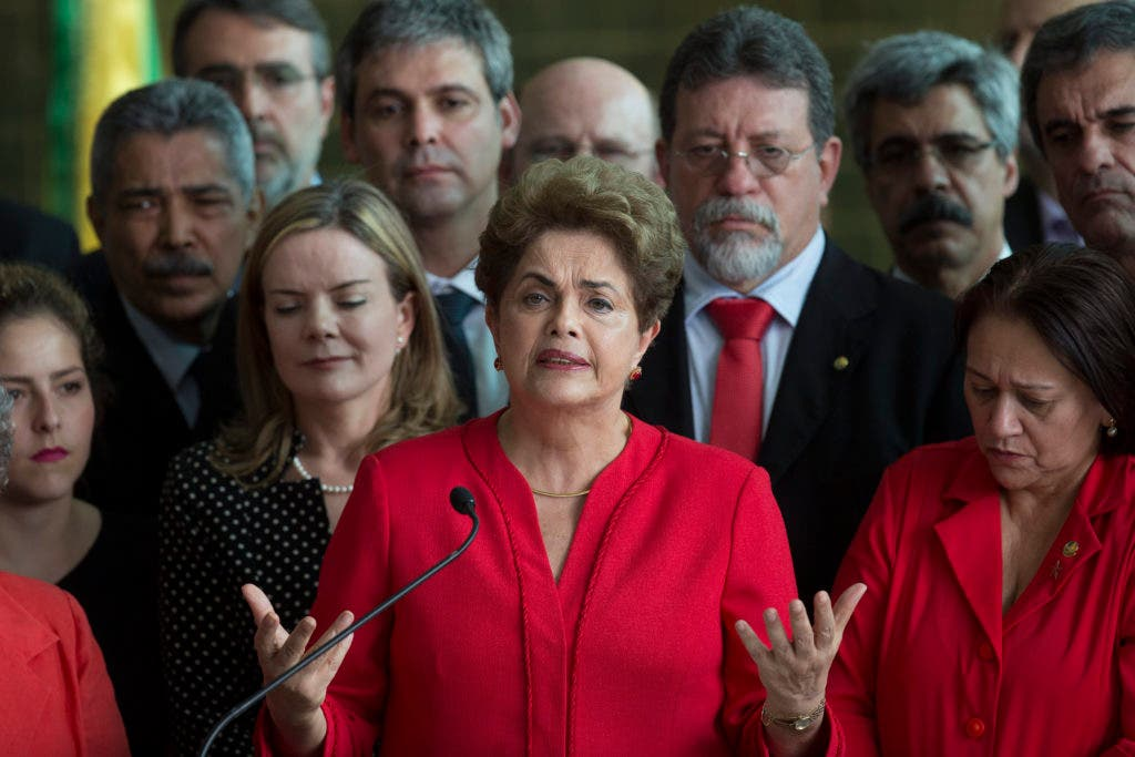 Brazil's suspended President Dilma Rousseff speaks from the official residence of the president Alvorada Palace, in Brasilia, Brazil, Wednesday, Aug. 31, 2016. In her first remarks after being ousted as Brazil's president, Rousseff is vowing to form a strong opposition front against the new government. (AP Photo/Leo Correa)
