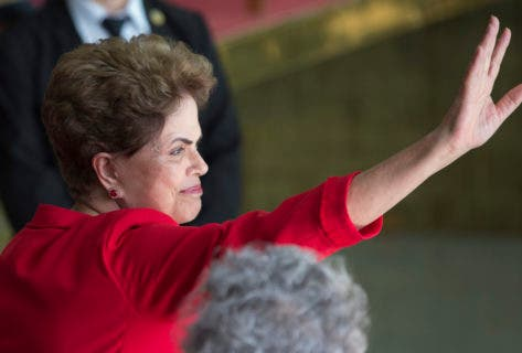 "Brazil's suspended President Dilma Rousseff waves to supporters before speaking from the official residence of the president, Alvorada Palace in Brasilia, Brazil, Wednesday, Aug. 31, 2016. In her first remarks after being ousted as Brazil's president, Rousseff is vowing to form a strong opposition front against the new government, saying, ""They think that they beat us, but they are wrong."" (AP Photo/Leo Correa)"