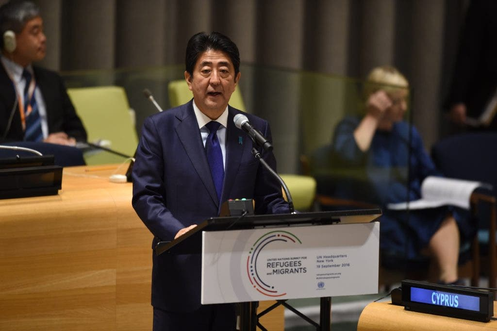 Japan's Prime Minister, Shinzo Abe speaks during the High-level plenary meeting on addressing large movements of refugees and migrants in the Trusteeship Council Chamber during the 71st session of the United Nations in New York September 19, 2016. A summit to address the biggest refugee crisis since World War II opens at the United Nations on Monday, overshadowed by the ongoing war in Syria and faltering US-Russian efforts to halt the fighting. World leaders will adopt a political declaration at the first-ever summit on refugees and migrants that human rights groups have already dismissed as falling short of the needed international response.  / AFP / TIMOTHY A. CLARY