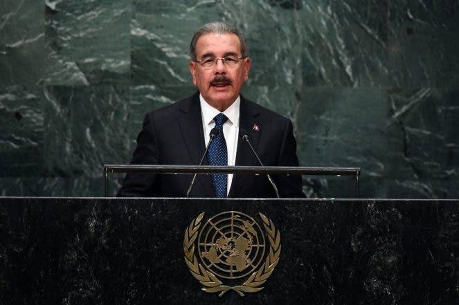 Dominican Republic's President Danilo Medina Sánchez addresses the 71st session of the United Nations General Assembly at the UN headquarters in New York on September 21, 2016.   / AFP / Jewel SAMAD