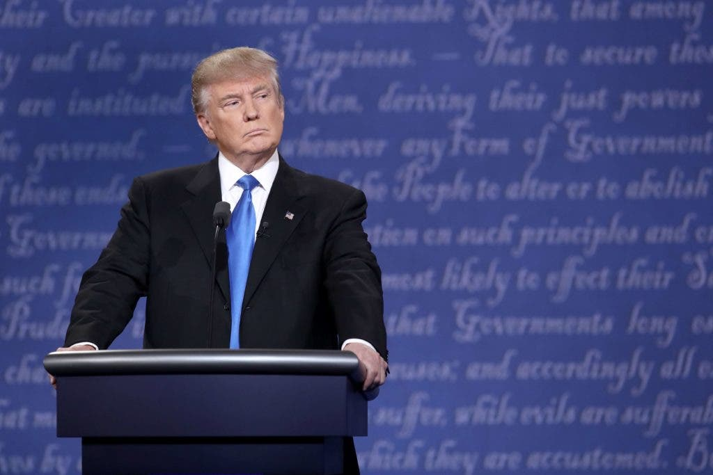HEMPSTEAD, NY - SEPTEMBER 26: Republican presidential nominee Donald Trump stands at his podium during the Presidential Debate at Hofstra University on September 26, 2016 in Hempstead, New York. The first of four debates for the 2016 Election, three Presidential and one Vice Presidential, is moderated by NBC's Lester Holt.   Win McNamee/Getty Images/AFP == FOR NEWSPAPERS, INTERNET, TELCOS & TELEVISION USE ONLY ==