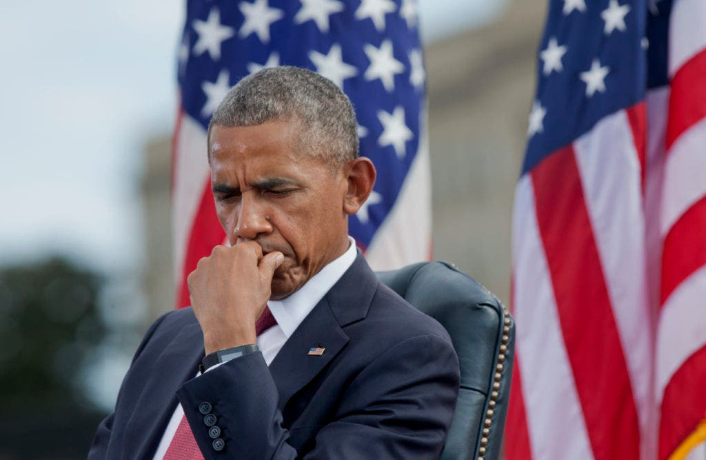 President Barack Obama listens as Secretary of Defense Ash Carter speaks during a memorial ceremony to commemorate the 15th anniversary of the 9/11 terrorist attacks, Sunday, Sept. 11, 2016, at the Pentagon in Washington. (AP Photo/Manuel Balce Ceneta)