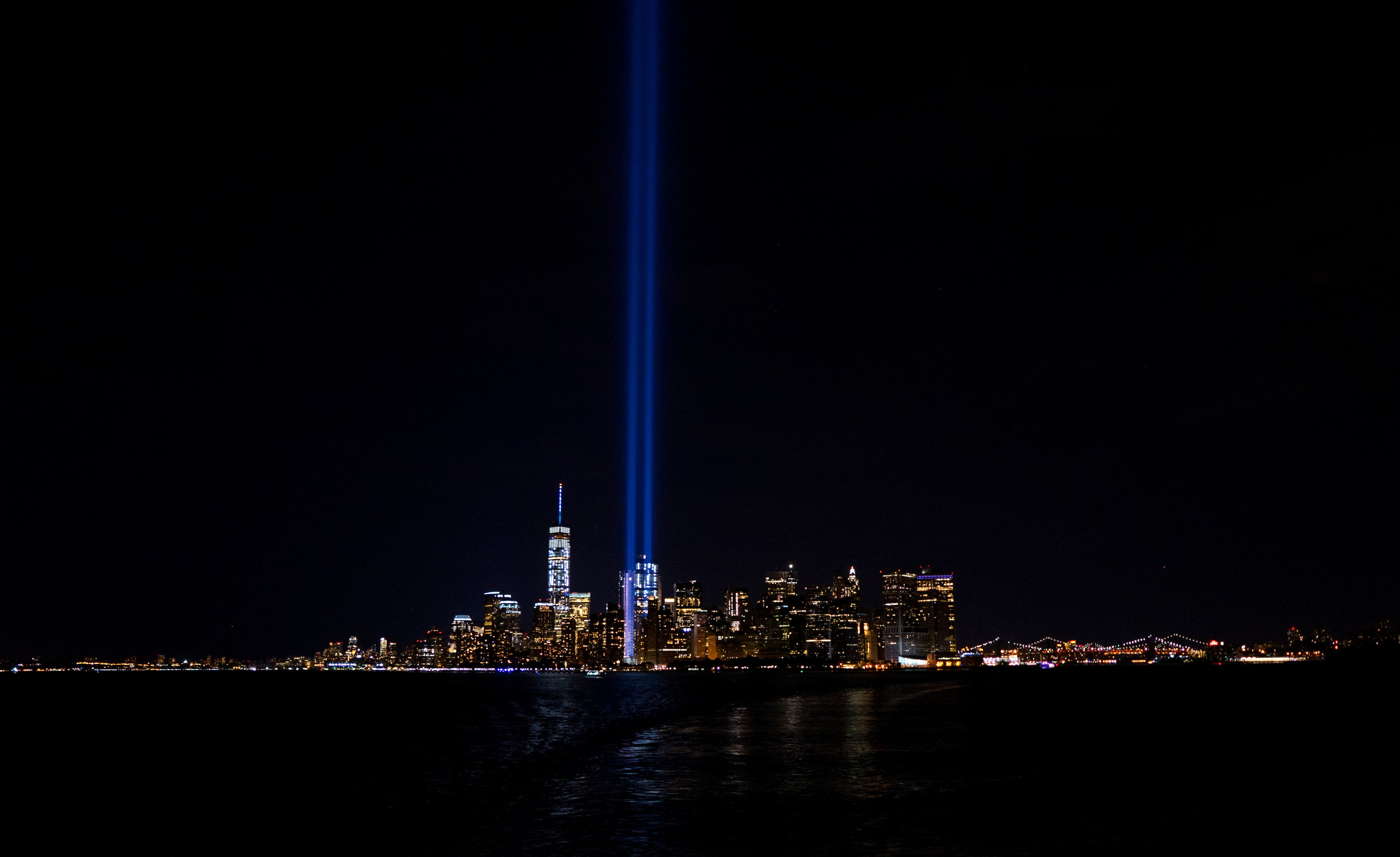 The Tribute in Light, viewed from the Staten Island Ferry, rises above the lower Manhattan skyline, Sunday, Sept. 11, 2016, in New York, the fifteenth anniversary of the terrorist attacks of Sept. 11, 2001 on the United States. (AP Photo/Craig Ruttle)