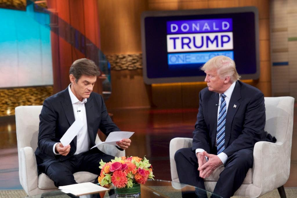 """This image released by  Sony Pictures Entertainment shows Dr. Oz, left, and Republican presidential candidate Donald Trump during a taping of """"The Dr. Oz Show,"""" in New York. The show will air on Thursday, Sept. 15. (Sony Pictures Entertainment via AP)"""