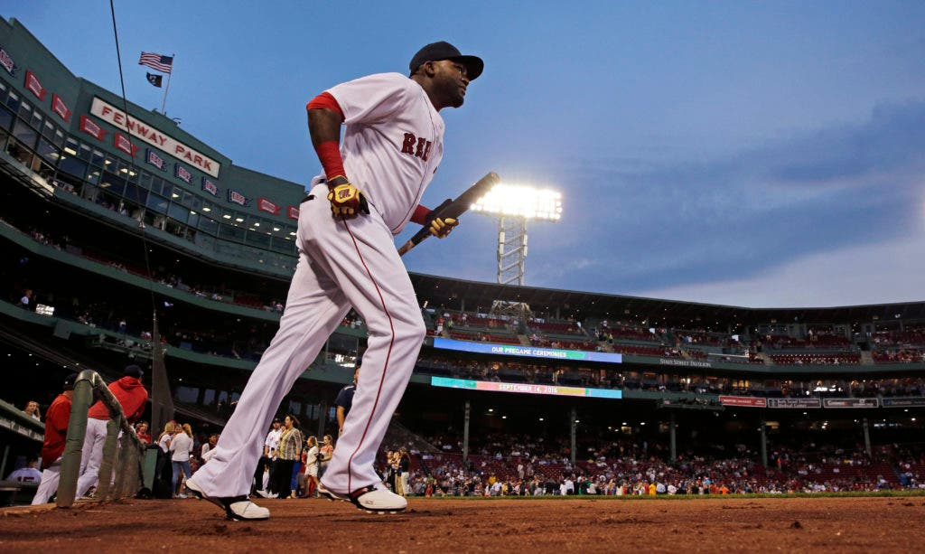 Boston Red Sox designated hitter David Ortiz heads onto the field to warm up prior to the tean;s baseball game against the Baltimore Orioles at Fenway Park, Wednesday, Sept. 14, 2016, in Boston. (AP Photo/Charles Krupa)