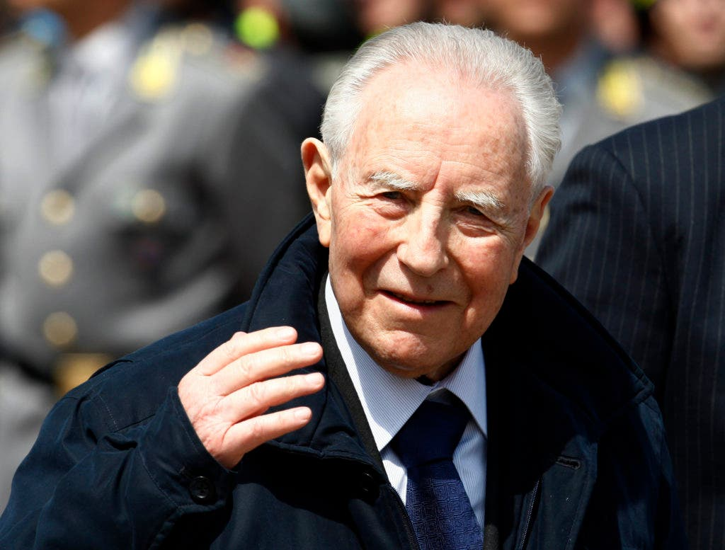 FILE - This April 10, 2009 file photo shows then Italian President Carlo Azeglio Ciampi attending the funeral service for quake victims in L'Aquila, central Italy. Ciampi died on Friday, Sept. 16, 2016 at the age of 95 after a long illness. (AP Photo/Luca Bruno, files)