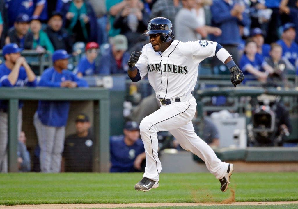 Seattle Mariners' Guillermo Heredia races home on a sacrifice fly by Robinson Cano against the Toronto Blue Jays in the 12th inning of a baseball game Wednesday, Sept. 21, 2016, in Seattle. The Mariners won 2-1 in 12 innings. (AP Photo/Elaine Thompson)