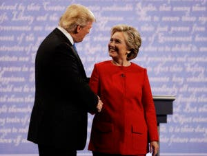 Democratic presidential nominee Hillary Clinton shakes hands with Republican presidential nominee Donald Trump during the presidential debate at Hofstra University in Hempstead, N.Y., Monday, Sept. 26, 2016. (AP Photo/Julio Cortez)