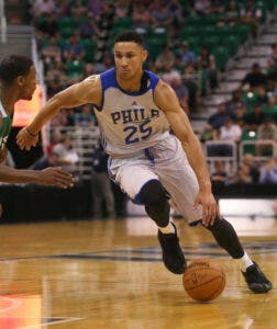 FILE - In this July 4, 2016, file photo, Philadelphia 76ers' Ben Simmons dribbles downcourt during an NBA Summer League basketball game against the San Antonio Spurs in Salt Lake City. No. 1 overall pick Simmons broke a bone in his right foot Friday, Sept. 30, 2016, during the 76ers' final training camp scrimmage at Stockton University. (AP Photo/Kim Raff, File)