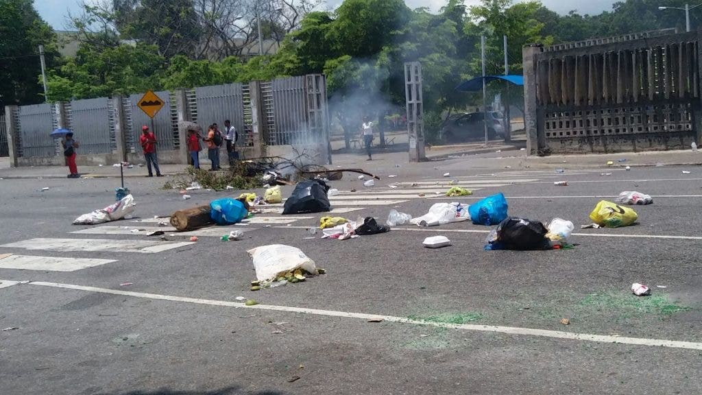 Resultado de imagen para UASD suspende docencia por disturbios