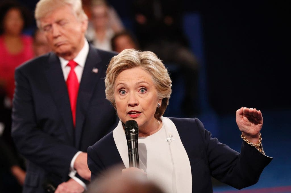 TOPSHOT - Democratic nominee Hillary Clinton (R) and Republican Presidential nominee Donald Trump participate in a town hall debate at Washington University in St. Louis, Missouri, on October 9, 2016.  / AFP / POOL / RICK WILKING
