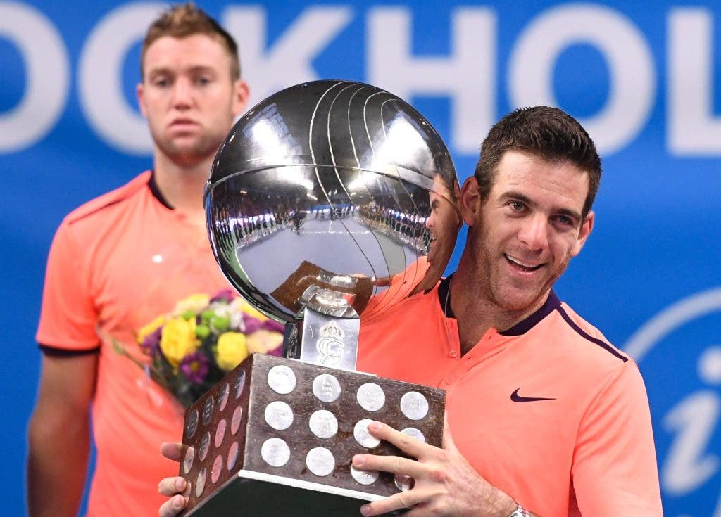 Juan Martin Del Potro reacts as he lifts the heavy trophy during an award ceremony after defeating USA's Jack Sock at the ATP Stockholm Open tennis tournament final match on October 23, 2016 in Stockholm.  / AFP / JONATHAN NACKSTRAND