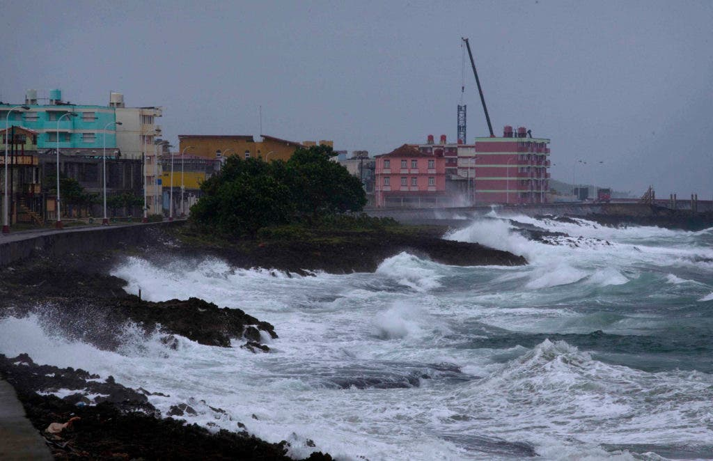 Waves crash against a seawall in Baracoa, Cuba, Tuesday, Oct. 4, 2016, before the arrival of Hurricane Matthew. The storm was moving along the Windward Passage between Haiti and Jamaica headed for southeastern Cuba and then the Bahamas. (AP Photo/Ramon Espinosa)