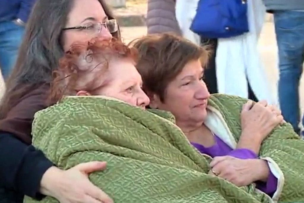 In this image made from video, two elderly women are wrapped in blankets, after an earthquake, in Norcia, Italy, Sunday, Oct. 30, 2016. A powerful earthquake with a preliminary magnitude of 6.6 has rocked the same area of central and southern Italy hit by quake in August and a pair of aftershocks last week, sending already quake-damaged buildings crumbling after a week of temblors that have left thousands homeless. (Sky Italia via AP)