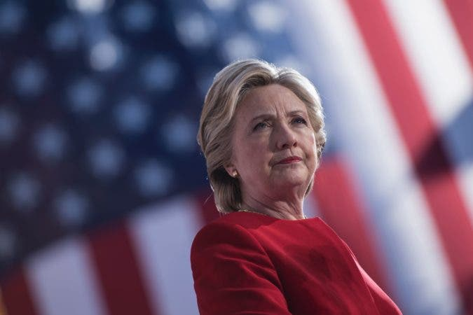 TOPSHOT - Democratic presidential nominee Hillary Clinton speaks during a rally outside the University of Pittsburgh's Cathedral of Learning November 7, 2016 in Pittsburgh, Pennsylvania. / AFP / Brendan Smialowski