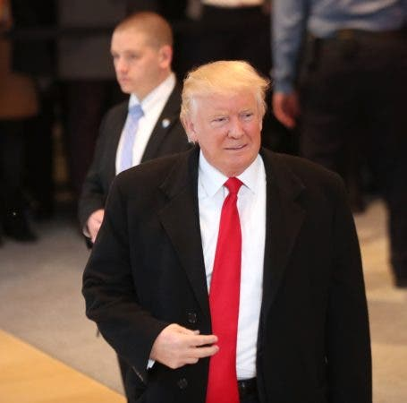 NEW YORK, NY - NOVEMBER 22: President-elect Donald Trump walks through the lobby of the New York Times following a meeting with editors at the paper on November 22, 2016 in New York City. Trump, who has held meetings with media executives over the last few days, has often had a tense relationship with many mainstream media outlets.   Spencer Platt/Getty Images/AFP == FOR NEWSPAPERS, INTERNET, TELCOS & TELEVISION USE ONLY ==