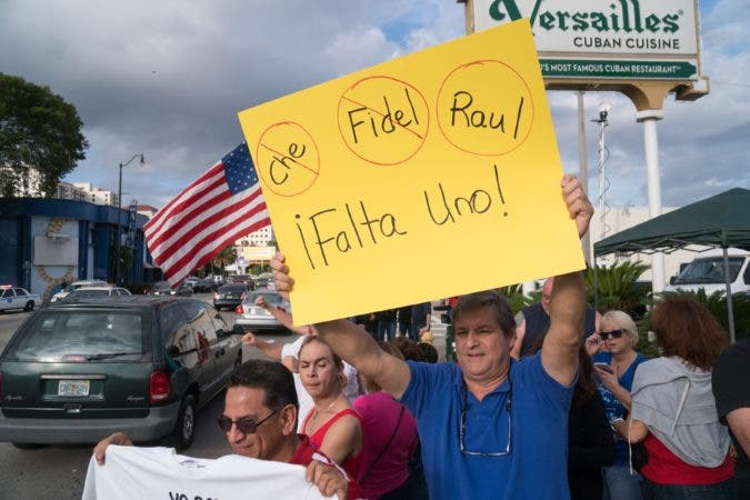 MIAMI, FL - NOVEMBER 26: People take to the streets to react to the news of the death of former Cuban President Fidel Castro outside the restaurant Versailles November 26, 2016 in Miami, Florida. Many, mostly Cubans, gathered to wave flags and celebrate the news of the death of the Cuban revolutionary who died at 90.   Angel Valentin/Getty Images/AFP == FOR NEWSPAPERS, INTERNET, TELCOS & TELEVISION USE ONLY ==