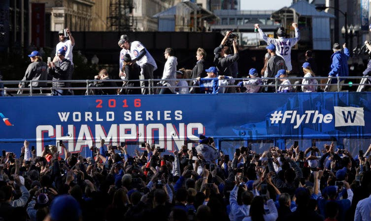 Chicago Cubs baseball players ride in a parade honoring the World Series champions in Chicago, Friday, Nov. 4, 2016. (AP Photo/Kiichiro Sato)