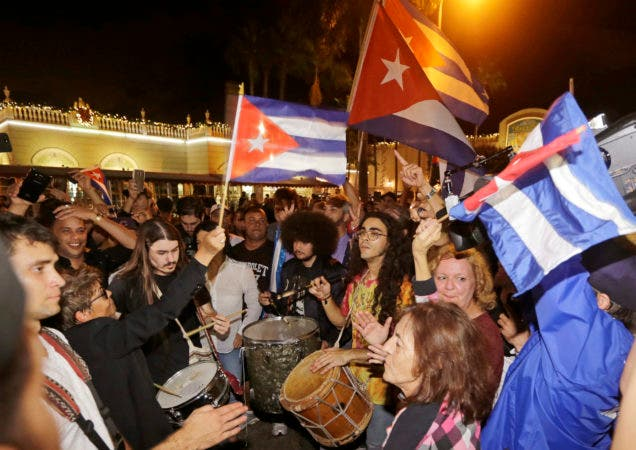Cuban-Americans celebrate the death of Fidel Castro, Saturday, Nov. 26, 2016, in the Little Havana area in Miami. Castro died eight years after ill health forced him to formally hand power over to his younger brother Raul, who announced his death late Friday, Nov. 25, on state television. (AP Photo/Alan Diaz)