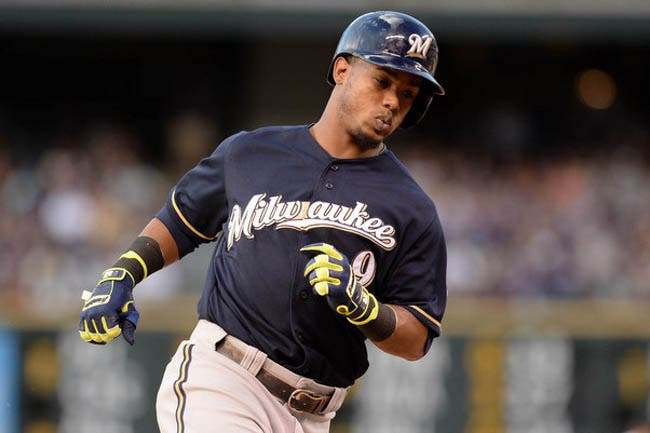 Jun 20, 2014; Denver, CO, USA; Milwaukee Brewers shortstop Jean Segura (9)  rounds the bases after his solo home run in the third inning against the Colorado Rockies at Coors Field. Mandatory Credit: Ron Chenoy-USA TODAY Sports